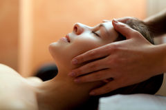 Woman having a facial massage Royalty Free Stock Image