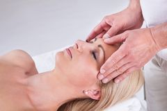 Woman having facial massage in spa centre Stock Photo