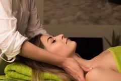Woman having facial massage Royalty Free Stock Photo
