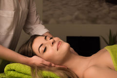 Woman having facial massage Royalty Free Stock Photography
