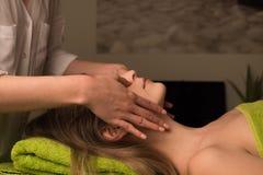 Woman having facial massage Royalty Free Stock Images