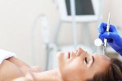 Woman having facial treatment in beauty salon. Picture of woman having facial treatment in beauty salon stock photos