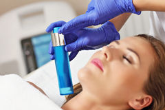 Woman having facial treatment in beauty salon Stock Images