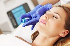 Woman having facial treatment in beauty salon Royalty Free Stock Photos