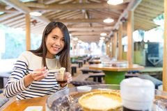 Woman having famous japanese somen in restaurant. Asian young beautiful woman portrait Royalty Free Stock Photography