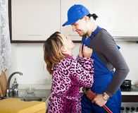 Woman having flirt with repairman. At kitchen stock images