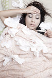 Woman having flu. Beautiful woman is holding her forehad because she has fever Royalty Free Stock Photos