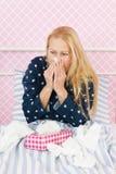 Woman having flu. Woman of mature age having flu Royalty Free Stock Image