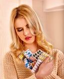 Woman having flu takes pills Royalty Free Stock Photo