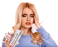 Woman having flu takes pills. Royalty Free Stock Images
