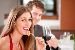 Woman Having Food in Restaurant Stock Images