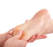 Woman having foot massage Stock Photos