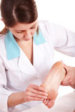 Woman having foot massage Royalty Free Stock Photo