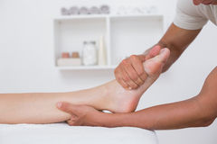 Woman having foot massage Royalty Free Stock Photos