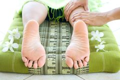 Woman having foot reflexology by therapist Stock Images