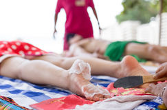 Woman having foot scrub on the beach Royalty Free Stock Photography