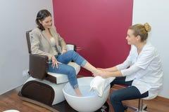 Woman having foot spa. Woman having a foot spa Royalty Free Stock Image