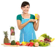 Woman having a fresh juice Royalty Free Stock Photography