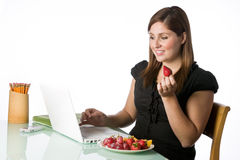 Woman having a fruit lunch Stock Photos