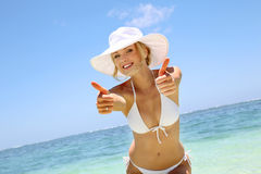 Woman having fun at the beach Stock Photos