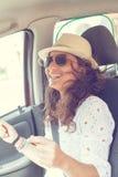 Woman having fun in the car. Happy woman having fun in the car Stock Image