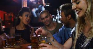 Woman having fun while drinking cocktail