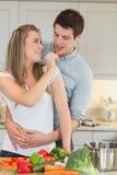 Woman having fun by feeding man Stock Images