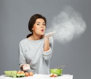 Woman having fun with flour Stock Image