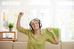 Woman having fun with headphones Royalty Free Stock Images