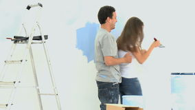 Woman having fun with her boyfriend during a renovation stock footage