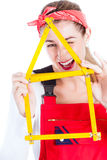 Woman having fun with home improvement Stock Images