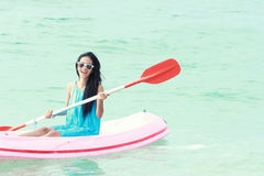 Woman having fun kayaking Royalty Free Stock Photo
