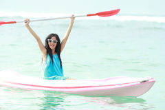 Woman having fun kayaking Royalty Free Stock Photography