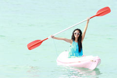 Woman having fun kayaking Royalty Free Stock Photos