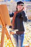Woman having fun laughing near easel Stock Image