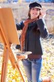 Woman having fun laughing near easel Stock Image