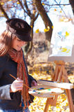 Woman having fun laughing near easel Stock Images