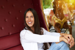 Woman having fun in merry-go-round Stock Photography