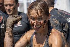 A woman having fun with the mud after strength race Stock Image
