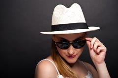 Woman having fun over dark background Stock Photography
