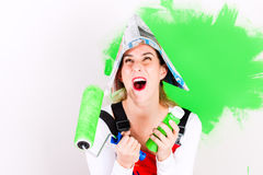 Woman having fun painting wall Royalty Free Stock Photo