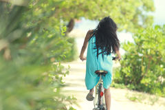 Woman having fun riding bicycle at the beach Royalty Free Stock Image