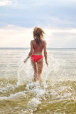 Woman having fun in the sea Royalty Free Stock Image