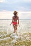 Woman having fun in the sea Royalty Free Stock Image