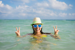 Woman having fun into the sea on summer vacation Stock Photography