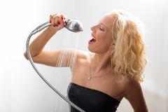 Woman having fun in the shower Stock Image