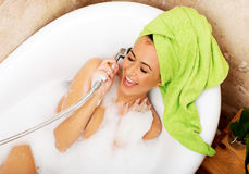 Woman having fun with showerhead Royalty Free Stock Images