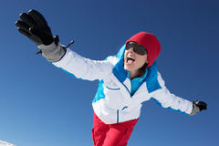Woman Having Fun On Ski Holiday In Mountains Royalty Free Stock Photo