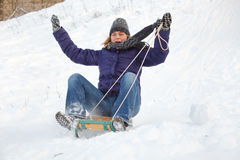 Woman having fun in snow Stock Images