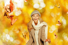 Woman having fun with some foliage outdoors Royalty Free Stock Photography